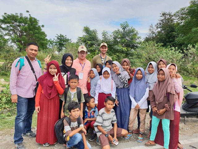 Mason in Palu with children
