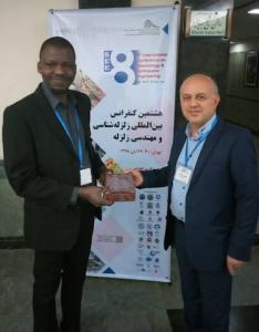 Akande Receiving a Souvenir from Dr. Farokh Parsizadeh