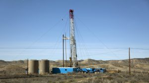 Drill rig and storage tanks Rangely Colorado